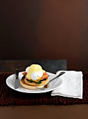 An English muffin with a poached egg and Hollandaise sauce