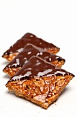 Close up of brittle dipped in chocolate