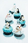 Penguin and snowman cupcakes