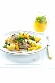 Chicken salad with mango, croutons, coriander and chilli