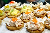 Small Slices of Toasted Bread Topped with Crab Salad and Egg Salad