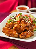Chicken wings with a cucumber salad