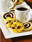 Cranberry and pistachio biscuits and black and white cookies with a cup of coffee