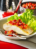 Fried halibut fillet with strawberry salsa