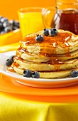 Lemon ricotta pancakes with maple syrup and blueberries