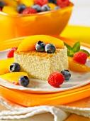 A slice of sponge cake garnished with fresh fruit