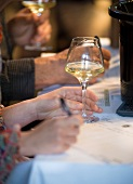 Degustation forms being filled out at a wine tasting session