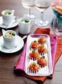Salmon bites with keta caviar and cups of pea soup