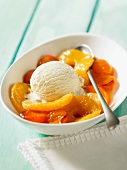 Warm fruit compote with vanilla ice cream