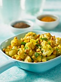 Indian cauliflower curry with potatoes and chickpeas
