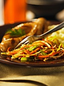 Julienned vegetables with sausages