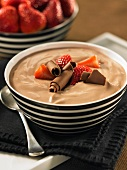 Chocolate yogurt with fresh strawberries and chocolate curls
