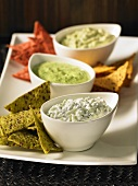 Tortilla chips with three different dips