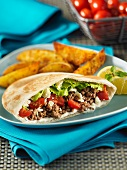 Pita bread filled with minced meat and feta cheese