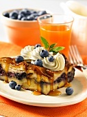 French toast with blueberries, maple syrup and cream