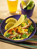 Corn tortilla filled with chicken breast and citrus salsa