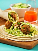 Pork meat balls with salad and tortillas