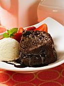 Chocolate lava cake with vanilla ice cream and fresh strawberries