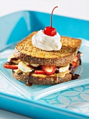 Peanut butter, banana, strawberry and chocolate sauce sandwich