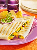 Quesadillas filled with mango and poblano