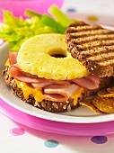 Grilled wholegrain bread topped with ham, pineapple and cheese