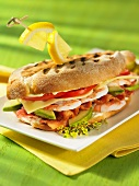 A prawn, bacon, avocado and cheese sandwich