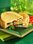 A spinach, goat's cheese and dried tomato panini