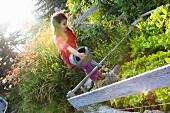 Girl watering lettuce garden