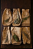 Six Dried Herbs on Brown Paper Bags with Labels