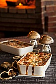 Dishes of mushroom lasagne with an oven in the background