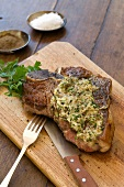Bistecca burro e acciughe (T-bone steak with anchovy butter)