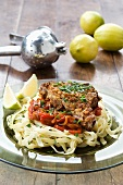 Veal cutlet with peperonata and ribbon pasta