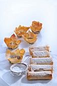 Puff pastry rolls and puff pastry bowls with icing sugar