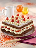Chocolate sponge cake with white chocolate cream and fresh strawberries