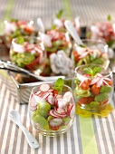 Bean salad with radishes and tomatoes in glasses
