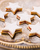 Star-shaped biscuits filled with jam