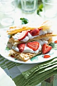 Puff pastry slices with poppyseed ice cream and fresh strawberries
