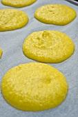 Piles of macaroon dough on baking paper