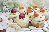 Cupcakes decorated with marzipan fruits and hortensia flowers