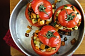 Baked tomatoes stuffed with sweet peppers, aubergines, courgettes and croutons