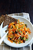Carrot, raisin, pineapple, cheese, spring onion and walnut salad with rye bread