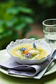 Organic vegetable soup with edible flowers