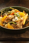 Braised chicken with apple wine, potatoes, oranges and thyme