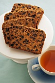 Spiced raisin cake with a cup of tea