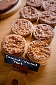 Mini Coconut Almond Tarts on a Wooden Board; With Sign