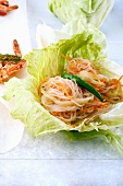Glass noodle salad with carrots and cucumber strips in a spicy sauce