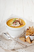 Cream of gold pea soup with chicken strips and homemade crackers