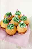 Lime cupcakes decorated with green chocolate cream and sugar sprinkles