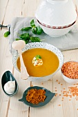 Red lentil soup with curry, creme fraiche and basil