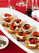 Crostini topped with strawberries, brie and balsamic cream